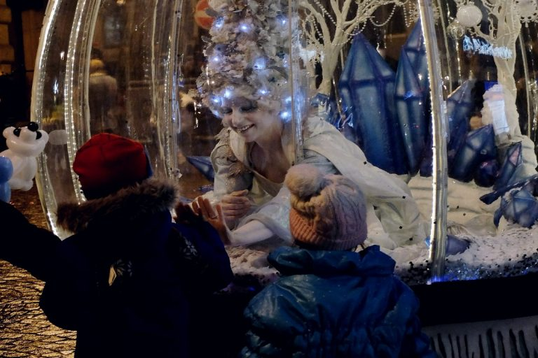 Living Snow Globe act at night meeting 2 young friends